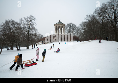 Sledging in the English Garden - Stock Photo
