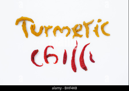 The word Turmeric and Chilli spelt in dried turmeric rhizomes and dried red chilli's on a white background - Stock Photo