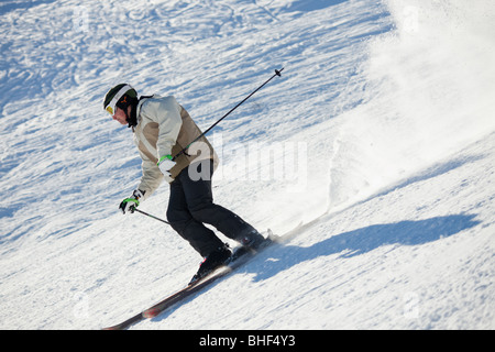 Skier on slope, Les Sybelles, French Alps. Copy space - Stock Photo