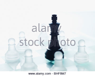Black and glass chess pieces - Stock Photo