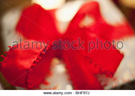 Close up of red ribbon on gift - Stock Photo