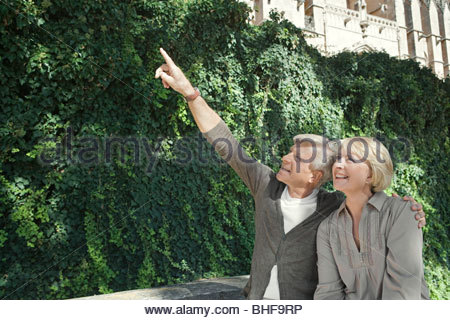 Man and woman pointing - Stock Photo