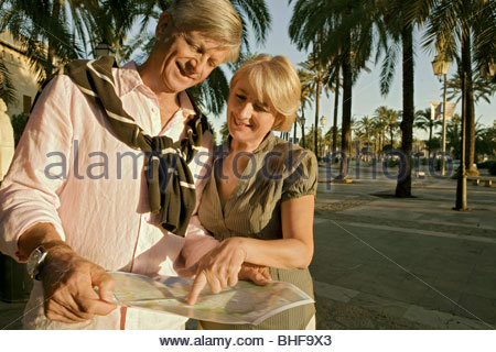 Man and woman reading map - Stock Photo