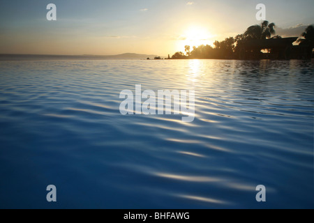 View over the Infinity Pool of the Peacock Garden resort in the evening, Baclayon, Bohol, Philippines, Asia - Stock Photo