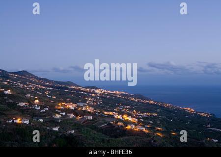 Viewpoint from Ermita de San Bartolome at sunrise, La Galga, east coast and village, Los Galguitos, UNESCO Biosphere - Stock Photo