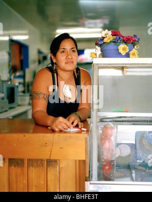 Maori Barb Stainton works at fastfood restaurant on main street, Te Araroa, Eastcape, North Island, New Zealand - Stock Photo