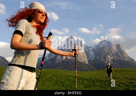 A woman and a man nordic walking in a mountain scenery, Sciliar, South Tyrol, Italy, Europe - Stock Photo