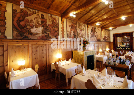 Tables are laid at the dining area of Hotel Zirmerhof, Radein, South Tyrol, Italy, Europe - Stock Photo