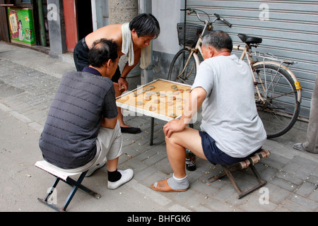 people playing Chinese checkers on the street. Beijing, China - Stock Photo