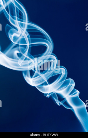 Jet of white smoke against a blue background - Stock Photo