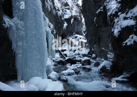 Partnach-Klamm, a deep gorge in the Alps near Garmisch-Partenkirchen, Bavaria, Germany. It's almost completely frozen - Stock Photo