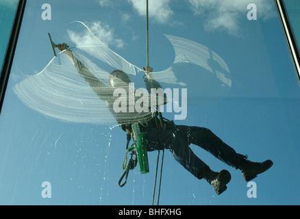 window cleaner on the outside of the Baltic Centre, Gateshead, Tyne and Wear, England, UK - Stock Photo