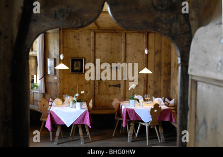 Tables are laid at the dining area of restaurant Steinbock, Villanders, Valle Isarco, South Tyrol, Italy, Europe - Stock Photo