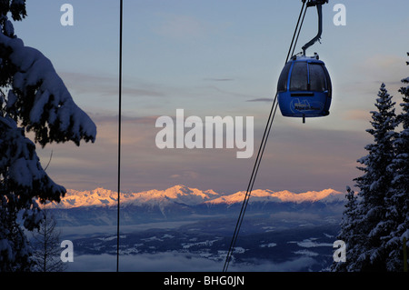 Passenger cabin of a cable car on a winter's evening, view at a valley, Alpe di Siusi, Valle Isarco, South Tyrol, - Stock Photo