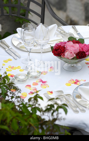 A table is laid on the terrace of Hotel Turmwirt, Voels am Schlern, South Tyrol, Italy, Europe - Stock Photo