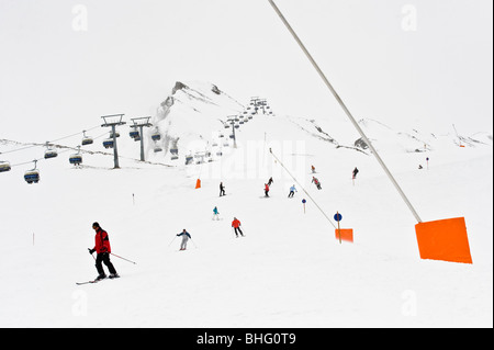 Skiers on slope, chairlift in background, Hintertux, Tyrol, Austria - Stock Photo