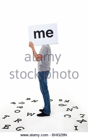Man with sign saying me - Stock Photo