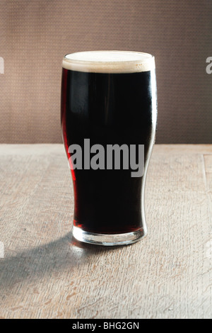 Pint of beer on table - Stock Photo
