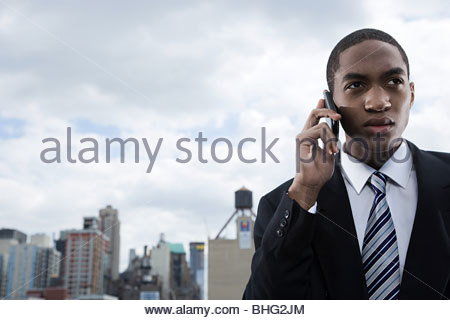 Businessman using cellphone - Stock Photo