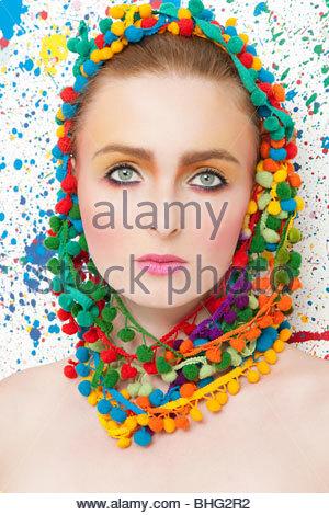 Young woman wearing colourful headdress - Stock Photo