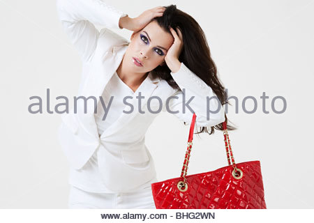 Young woman with hands in hair - Stock Photo