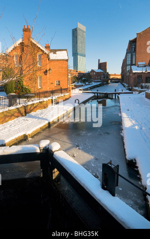 Dukes 92 lock frozen Rochdale canal winter sun Manchester's Beetham tower in the distance - Stock Photo