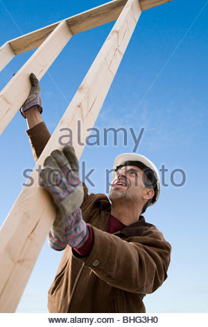 Man with construction frame - Stock Photo
