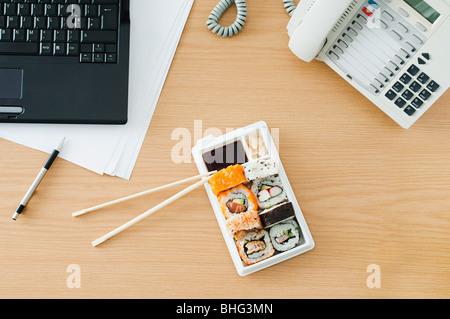 Sushi at desk - Stock Photo