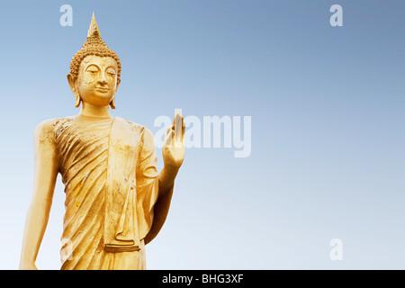 Standing buddha figure in thailand - Stock Photo