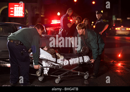 Emergency services at scene of accident - Stock Photo