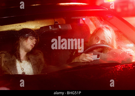 Two young women in a car accident - Stock Photo