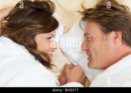 Mature couple in bathrobes - Stock Photo