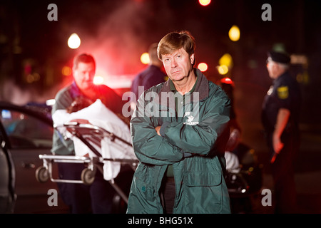 Emergency medical technician at scene of accident - Stock Photo
