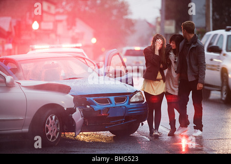 Young people involved in a car crash - Stock Photo