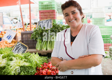 Woman trader at vegetable stall - Stock Photo