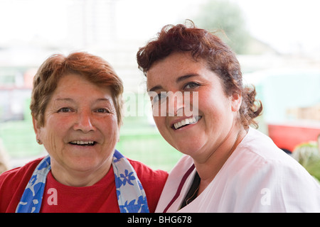 Two female market traders - Stock Photo