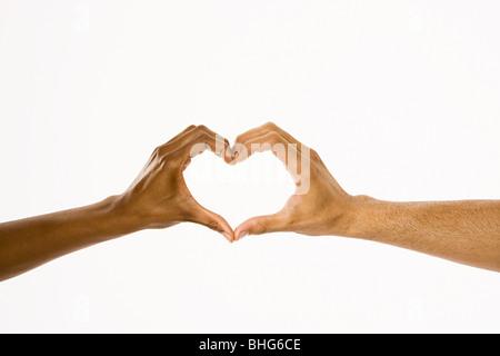 Hands in heart shape - Stock Photo