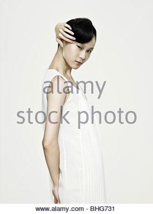 Asian woman touching her eye - Stock Photo