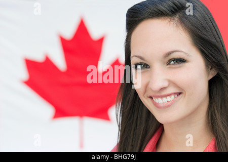 Young woman and canadian flag - Stock Photo