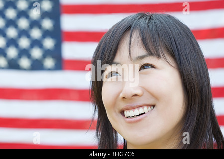 Woman and american flag - Stock Photo
