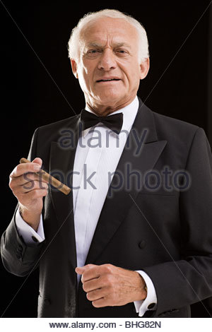 Man in dinner jacket with cigar - Stock Photo