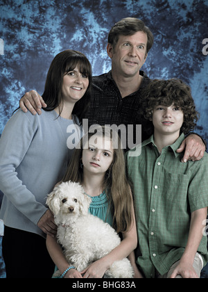 Portrait of a family with poodle - Stock Photo