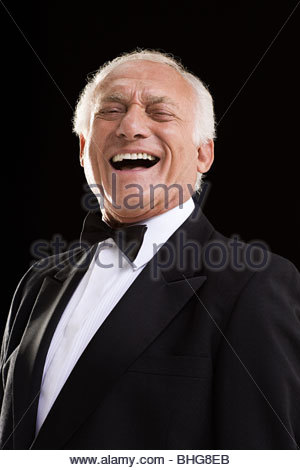 Laughing man in a dinner jacket - Stock Photo