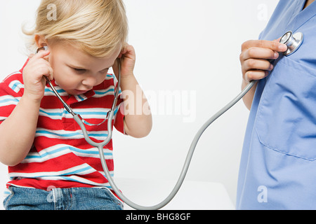 Little boy and nurse with stethoscope - Stock Photo