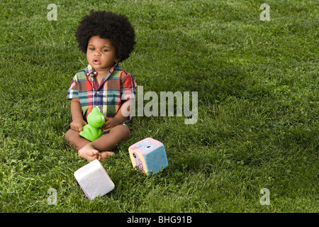 Baby in park with toys - Stock Photo