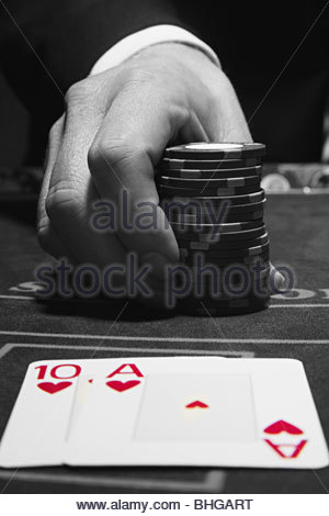 Cards and hand with gambling chips - Stock Photo