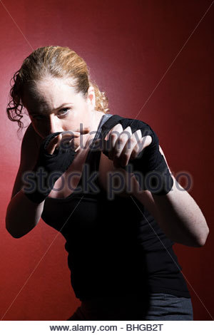 Woman in boxing stance - Stock Photo