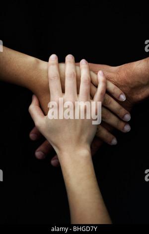 Three hands. - Stock Photo