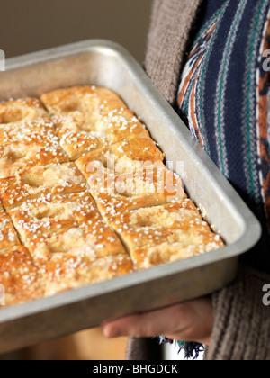 Buns in a baking tin, Sweden. - Stock Photo