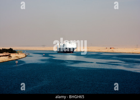 Ship passing through the Suez Canal - Stock Photo